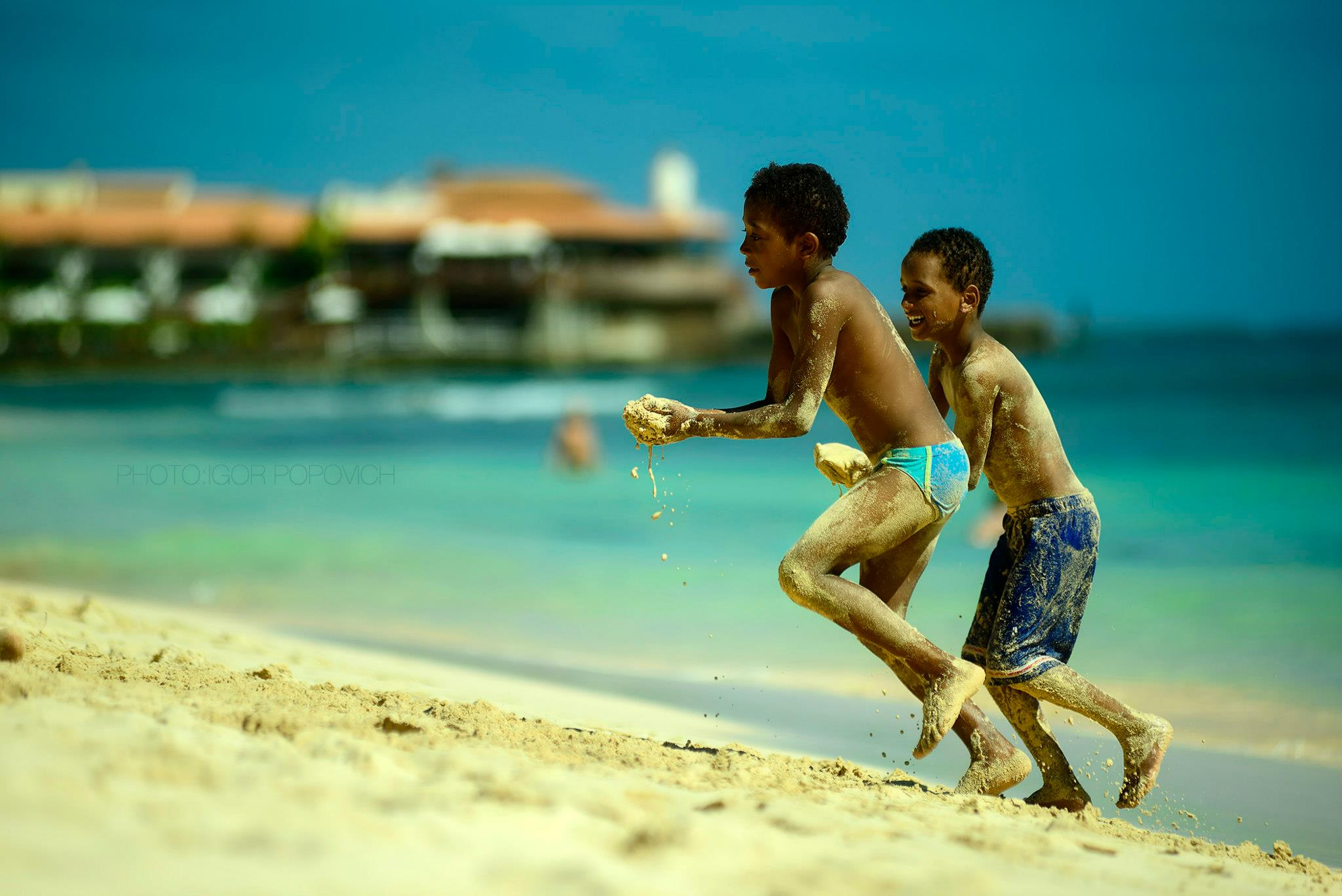 Children playing on a beach of Sal island
